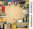 Carpentry tools on a wooden board. - stock photo