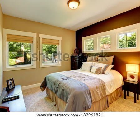 Carpet bedroom with contrast color wall. Beautiful bedding. - stock photo