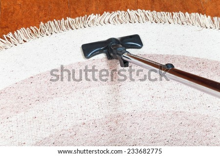 carpet cleaning with a hoover at home - stock photo