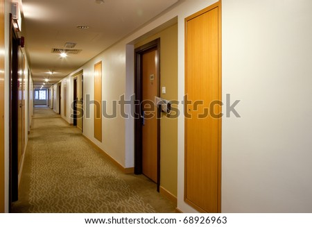 Carpeted hallway inside a building - stock photo