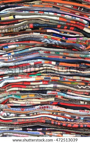Carpets folded for sale in a carpet store