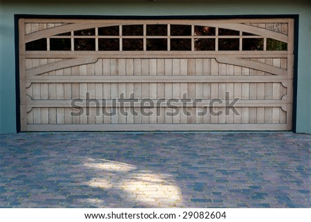 Carriage doors on a large California home - stock photo