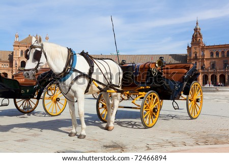 Carriage in front of Spanish Square in Sevilla, Spain - stock photo