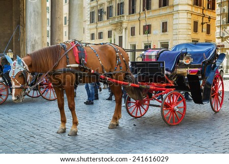 carriage to explore the city in Rome, Italy