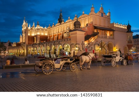 Carriages before the Sukiennice on The Main Market Square in Krakow, Poland - stock photo