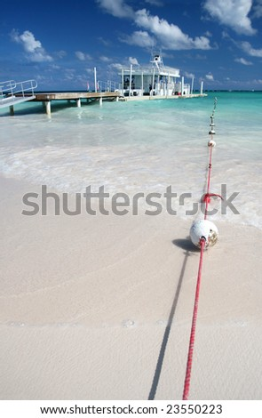 Carribean Landscape - Bouys, Pier and Ferry Boat in a Tropical Ocean, White Sand Beach