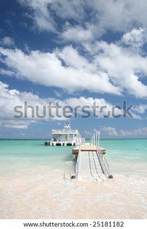Carribean Landscape -  Pier and Ferry Boat in a Tropical Ocean, White Sand Beach - stock photo