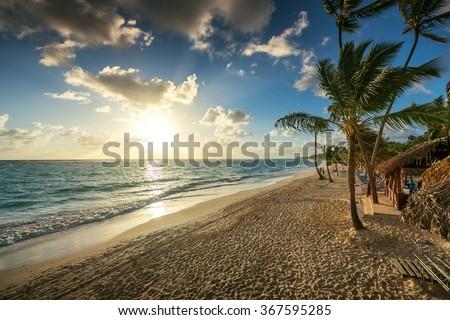 Carribean vacation, beautiful sunrise over tropical beach in Punta Cana - stock photo