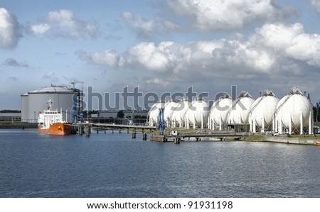 Carrier ship and oil  gas factory - stock photo