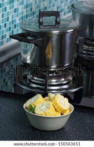 Carrot and corn vegeteble material  wait for do soup in the kitchen - stock photo