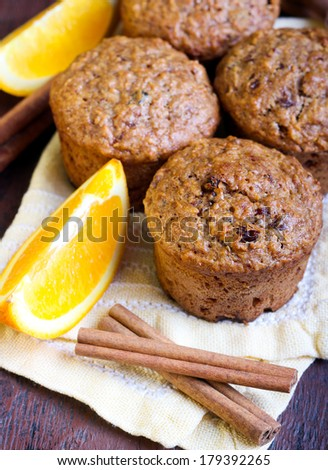 Carrot and marmalade muffins with cinnamon sticks and orange slices