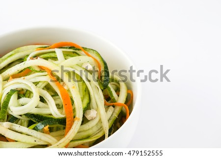Carrot and zucchini noodles isolated on white background