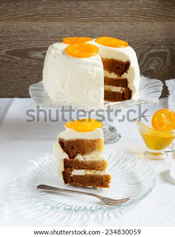 carrot cake decorated with candied oranges