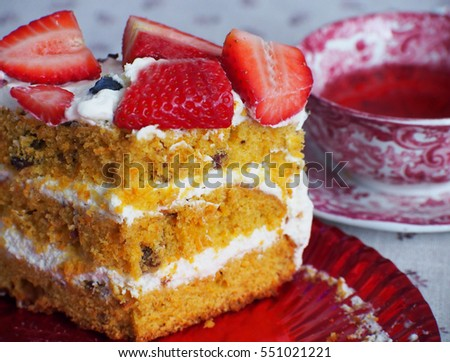 Carrot cake.Sweet pie with fresh strawberries.