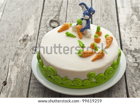Carrot cake with bunny decoration - stock photo