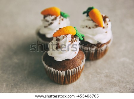 Carrot chocolate muffins on grey background