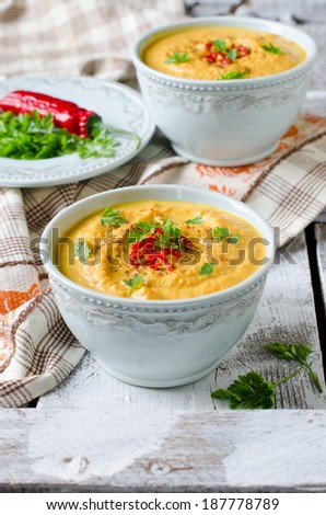 Carrot cream soup with red chili pepper - stock photo