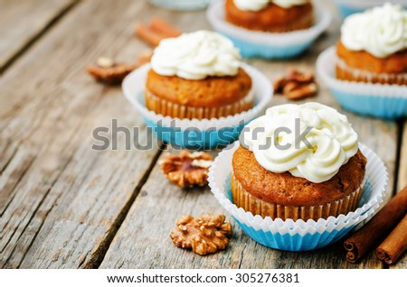 carrot cupcake on a dark wood background. the toning. selective focus - stock photo
