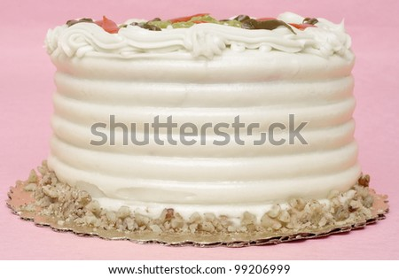 Carrot Flavored Birthday Cake on Pink Background. - stock photo