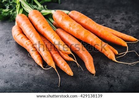 Carrot. Fresh Carrots bunch. Baby carrots. Raw fresh organic orange carrots. Healthy vegan vegetable food.  Fresh Vegetable. - stock photo