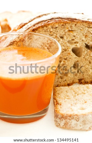 Carrot juice, carrots and carrot bread close up - stock photo
