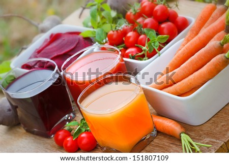 Carrot juice, tomato juice and beet juice - stock photo