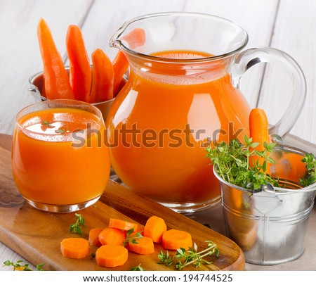 Carrot juice with fresh herbs. Selective focus - stock photo