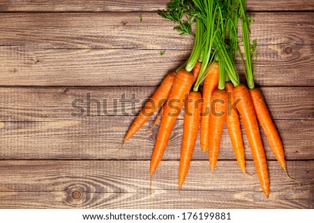 Carrot on a wooden table - stock photo