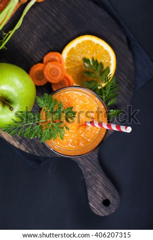 Carrot orange smoothie. Healthy lifestyle. Green concept.