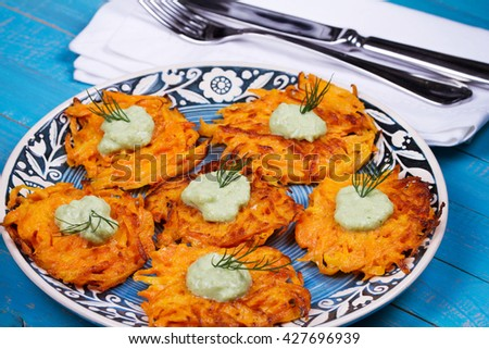 Carrot Pancakes With  Yogurt Sauce in Blue Plate