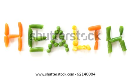 Carrot, pea, corn and green beans forming word health - close up view on white background - stock photo