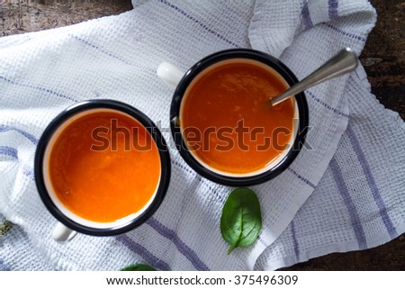 Carrot soup on a table in mugs. Homemade healthy food