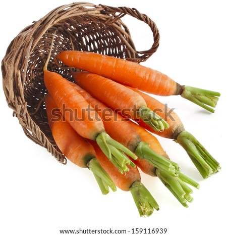 Carrot vegetables in a wooden basket isilated over white background  - stock photo