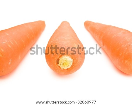 Carrots arranged and isolated on white
