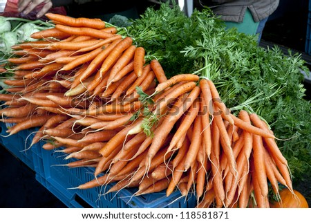 Carrots for sale on marketplace - stock photo