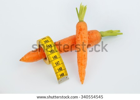 carrots from organic farming with tape measure. fresh fruits and vegetables is always healthy. symbolic photo for healthy diet. - stock photo