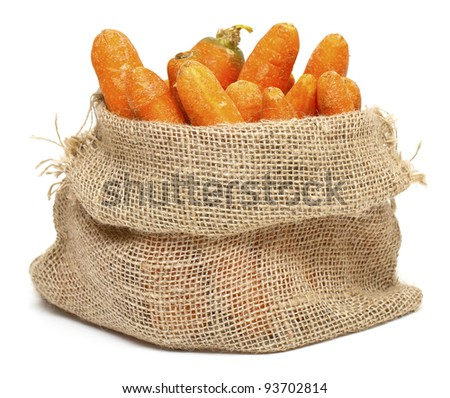 carrots in a burlap bag isolated on white background - stock photo