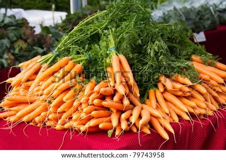 Carrots on display at the farmer's market - stock photo