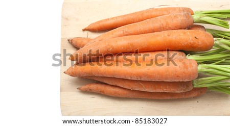 carrots on wooden board and empty space for your text - stock photo