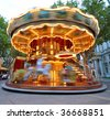 Carrousel in motion - stock photo