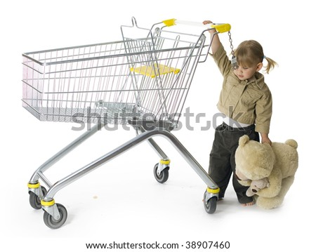 carrying bear little girl leads shop trolley - stock photo
