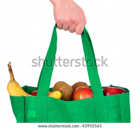 Carrying Groceries in Reusable Green Bag Isolated on White - stock photo