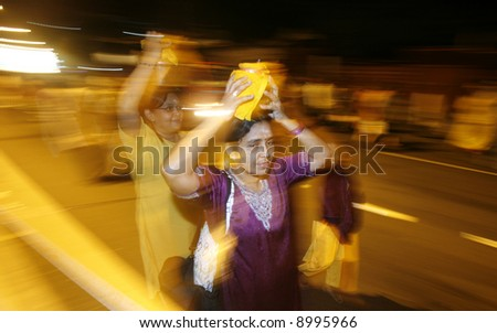 Carrying milkpots during Hindu festival of Thaipusam in Malaysia. - stock photo