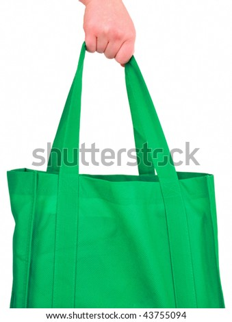 Carrying Reusable Green Bag Isolated on White - stock photo