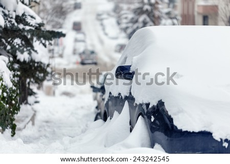 Cars and roads covered with snow - stock photo