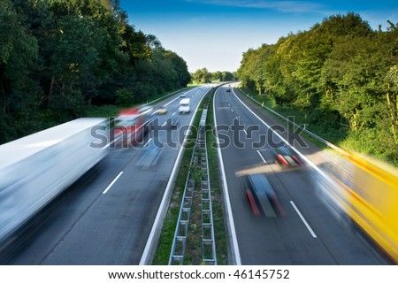 Cars and Trucks on a Motorway. Motion Blur. - stock photo