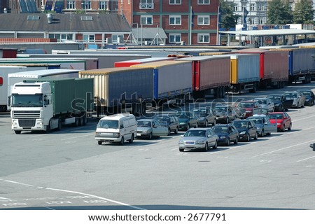 Cars and trucks wating at the ferry - stock photo