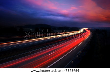 cars at night with motion blur. - stock photo
