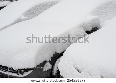 Cars covered by snow - stock photo