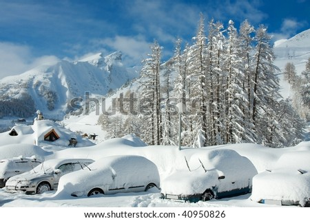 Cars covered by snow in the mountains in winter